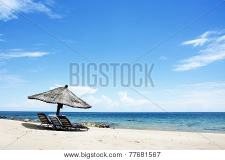 Umbrella on the Beach on a Sunny Day, Chintheche Beach, Lake Malawi, Africa