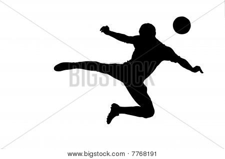 A silhouette of a soccer player with a ball