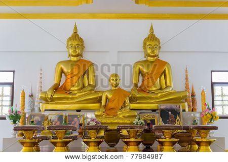 Buddha Image And Buddhist Monk Statue