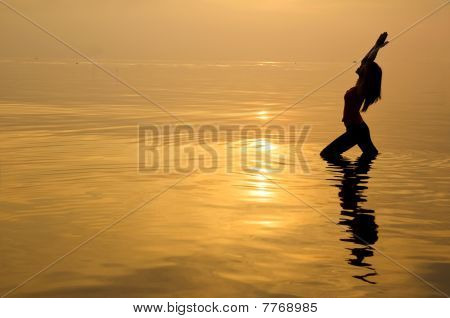 Asian Girl Performing Yoga On A Beach
