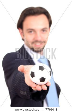 Businessman With A Soccer Ball Balanced On Finger