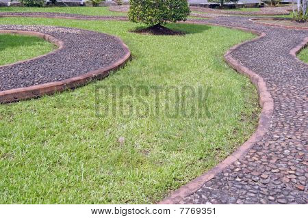 Massage for feet on a garden path. Borneo
