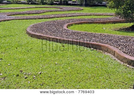 Massage for feet on a garden path. Borneo