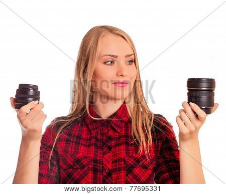 Attractive female photographer choosing lens - isolated on white