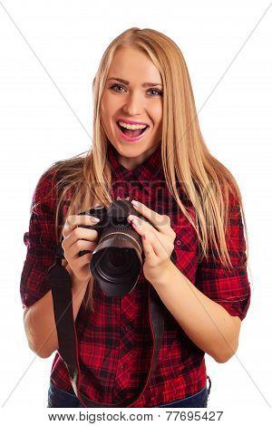 Female photographer holding a professional camera - isolated ove