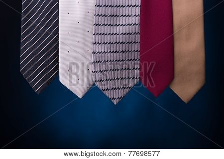 Set Of Multicolored Neckties Men's Fashion. On A Blue Background.