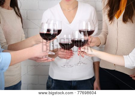 Woman hands with glasses of wine close-up