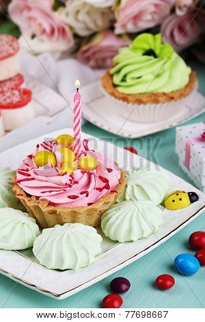 Sweet cakes on birthday table close-up