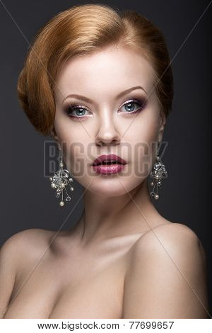 Portrait of a beautiful ginger woman in the image of the bride. Beauty face