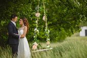 pic of swing  - Beautiful couple bride and groom in wedding suit enjoy moments of happiness - JPG