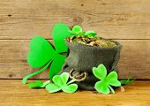 picture of pot gold  - green clover leaves and a bag of gold  - JPG