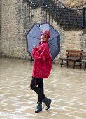 foto of dancing rain  - Young happy pretty woman standing in the rain - JPG