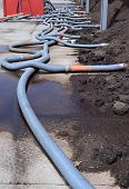 foto of aeration  - Industrial compost heap with forced aeration pipes and leachate drainage - JPG