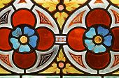 image of stained glass  - stained glass with two red flowers in Prague - JPG