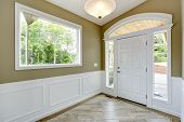 stock photo of windows doors  - Entrance hallway with tile floor and beige wall with white trim - JPG