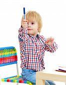 picture of montessori school  - Little boy draws felt - JPG