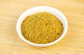 picture of flaxseeds  - Flaxseed meal powder in white bowl on wood - JPG