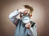 pic of diligent  - Portrait of cute diligent boy holding alarm clock - JPG