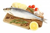 pic of frozen food  - Fresh raw fish on cutting board and food ingredients isolated on white - JPG