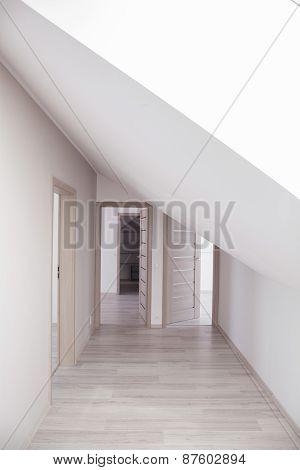 Bright Corridor With Beige Doors