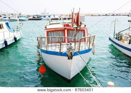 Fishing boats in old port in Mediterranean sea