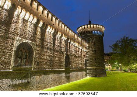 Night photo of Sforza Castle (Castello Sforzesco) in Milan, Italy
