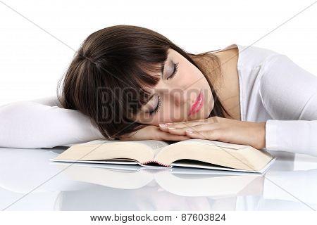 beautiful girl sleeping on a book