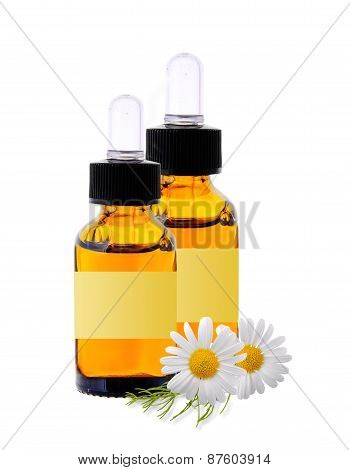 Bottles With Essence Oil And Chamomiles Isolated On White