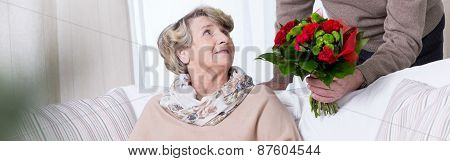 Senior Woman Getting Anniversary Bouquet