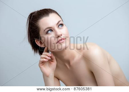 Portrait of pretty nude woman with natural makeup