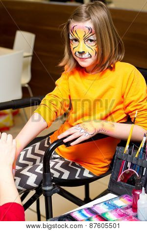 Girl Getting Her Hands And Face Painted