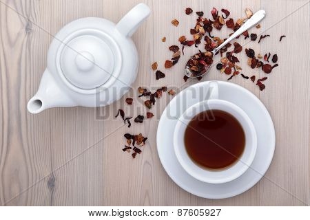 cup of tea with teapot and spices on the table