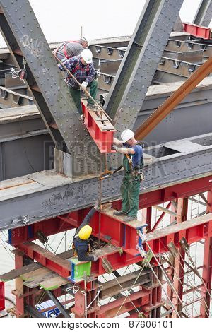Workers Attaching Carrying Platform To Bridge, Editorial