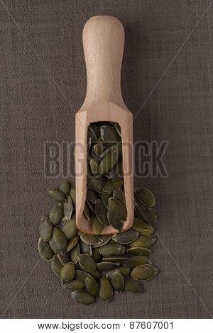 Wooden Scoop With Pumpkin Seeds