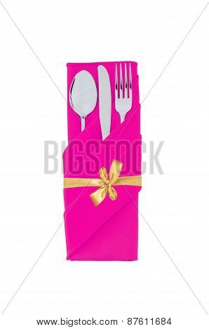 Fork, Spoon And Knife In Pink Cloth With Golden Bow Isolated On White