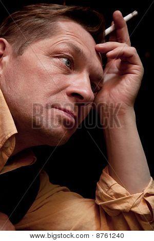 A Solitary Man Sits At A Bar