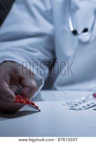 Doctor's Hand Holding Tablets