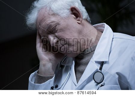 Elder Doctor Suffering For Migraine