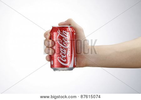 Kuala Lumpur,Malaysia 9th April 2015, hand holding a red Coca Cola can drinks.Coca Cola drinks are produced and manufactured by The Coca-Cola Company