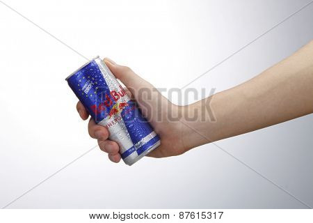 Kuala Lumpur,Malaysia 9th April 2015,Hand holding Can of Red Bull Energy Drink isolated on white background.