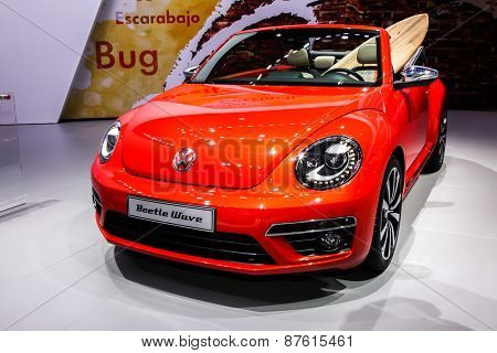 NEW YORK - APRIL 1: Volkswagen exhibit before Volkswagen Beetle wave at the 2015 New York International Auto Show during Press day,  public show is running from April 3-12, 2015 in New York, NY.