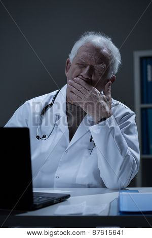 Overworked Doctor Yawning