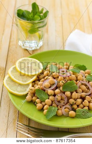 Vegetarian chickpeas salad with sweet red onions, mint and spices