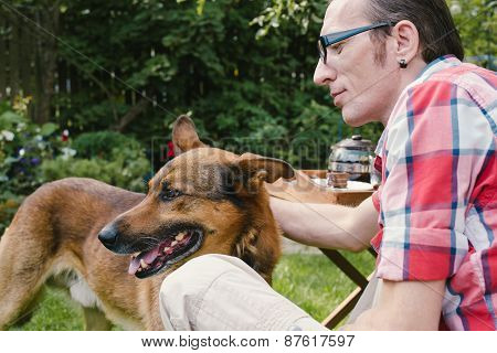 Man And His Dog Rest In The Garden