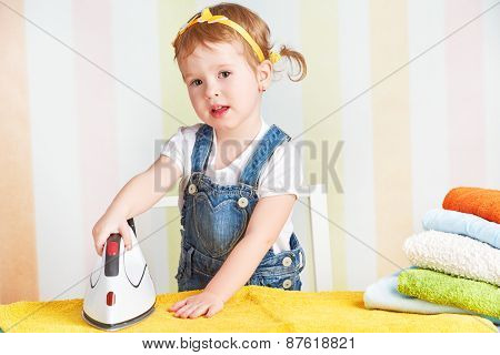 Cute  Baby Girl Housewife Iron Clothes Iron, Is Engaged In Domestic Work