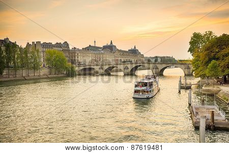 PARIS - SEPTEMBER 06, 2014: The Seine river in the evening. The Seine is a 776 km long river and an important commercial waterway within the Paris Basin in the north of France
