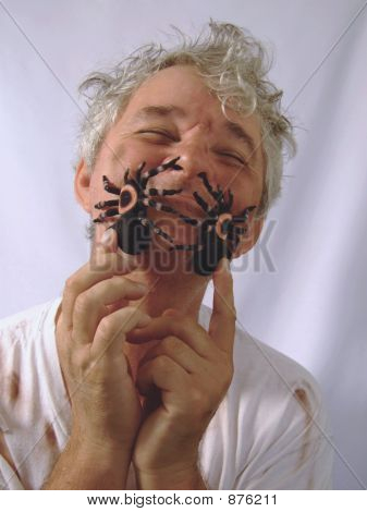 Dirty Senior With Eyes Closed And Pet Spiders