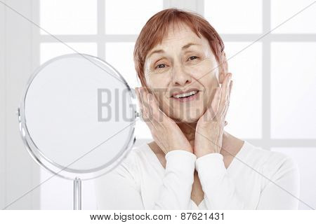 Sixty years woman and mirror