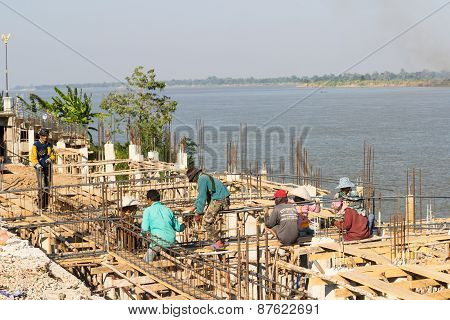 The Workers Are Constructing The Pier Beside Mekong River Near The Border Between Thailand And Laos