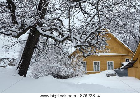 Russian winter. Traditional wooden house in the town of Izborsk near Pskov, Russia.